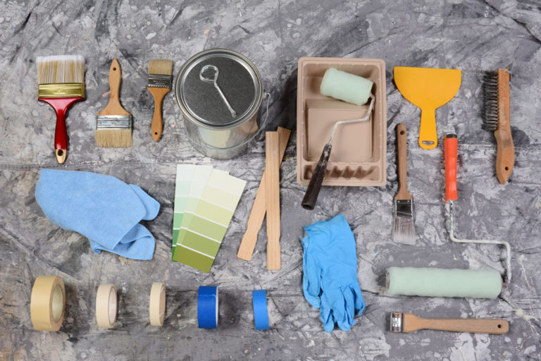 High angle shot of the tools needed to paint spread out on a dro